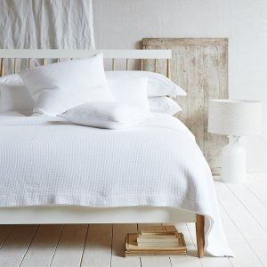 The White Company Cool and crisp cotton bedding never fails to smarten things up, especially if you like the pristine look of a five-star hotel. Woven for us in Portugal using the French matelassé technique that's designed to imitate the hand-stitched quilts of Marseille, Colville has a fabulous bumpy texture in the style of delicate brickwork. The bedspread comes in various sizes including our new emperor size, which is perfect for generous draping. For a totally coordinated look team with our matching cushion covers. Available in white 100% cotton