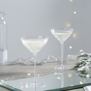 Inspired by the vintage style of the 1920s with a modern twist, our champagne glasses have been expertly mouth-blown from soda lime glass with a fire-polished edge. The elegance of the fine stem makes it the perfect glass for raising a glass and celebrating.